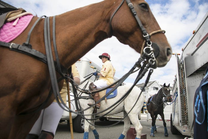 Club member Audrey Van Luvanne waits for other players to ride out to the beach. A player will use multiple horses during a match.  Saturday October 5, 2019. Long Beach Twp., NJ